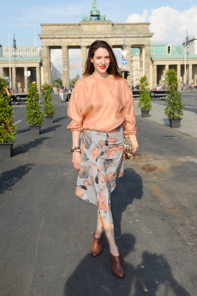 A lovely mix of hues and prints, finished with a pop of red lip and a leopard clutch.