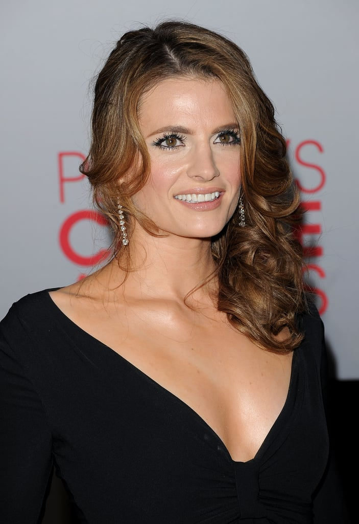 Stana Katic swept her hair to the side.