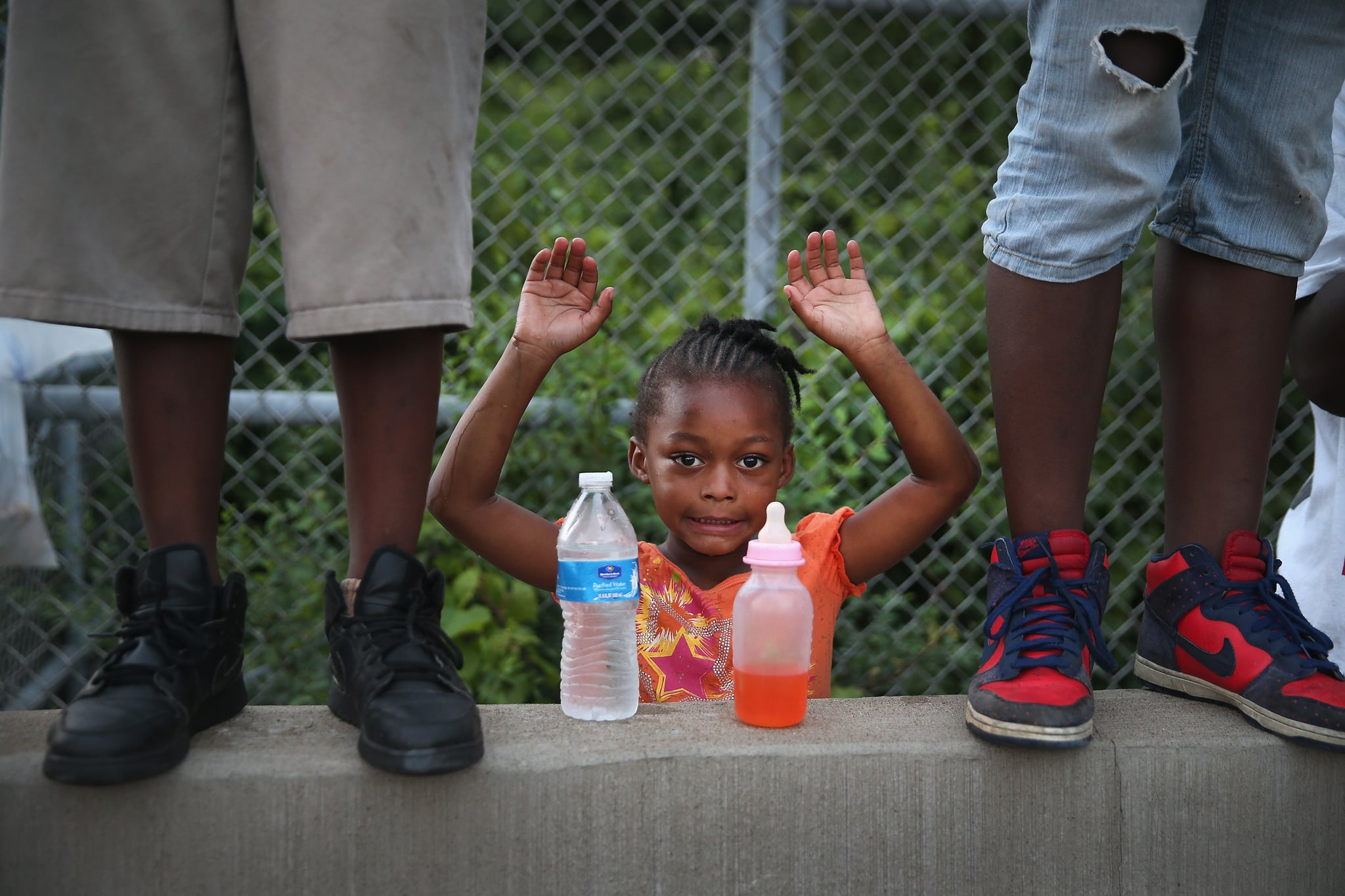 A child put her hands up in protest of the killing of Michael Brown.