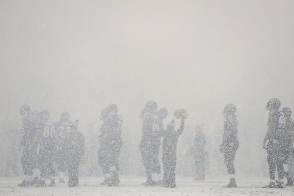 Heavy snow fell during a football game between the Baltimore Ravens and the Minnesota Vikings in Maryland.