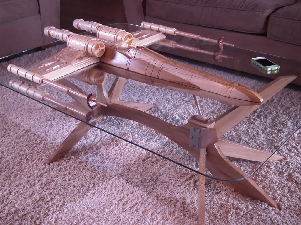 Oh this? No big deal, it's just a one-of-a-kind Star Wars X-wing coffee table ($5,500) straight outta your dreams.