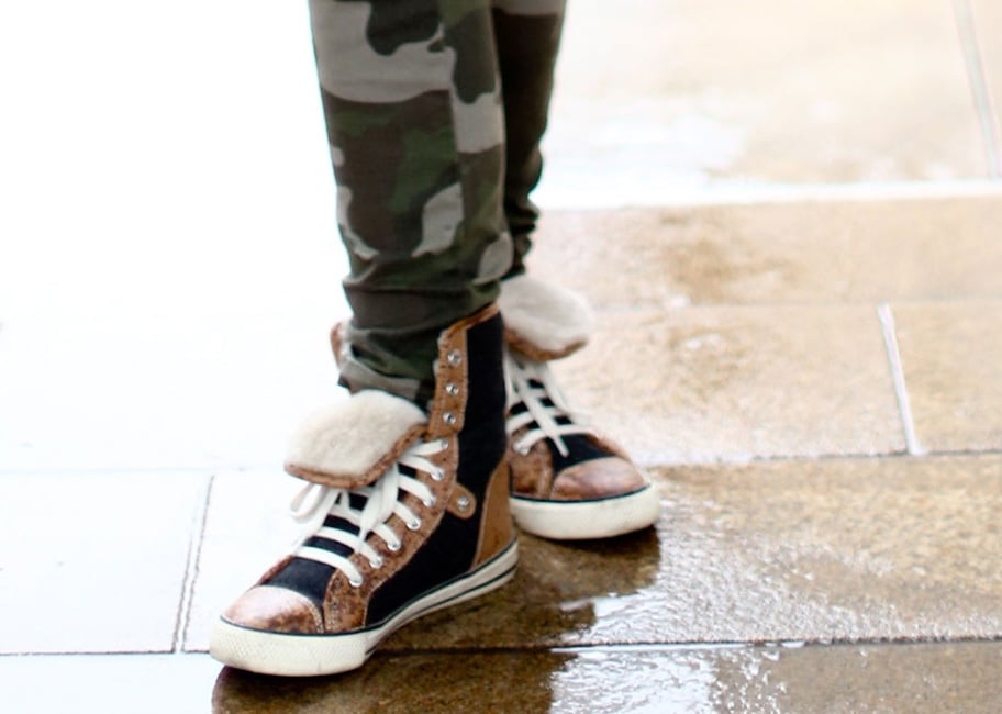 These shearling-lined high-tops provide as much cool factor as they do comfort around the tents.