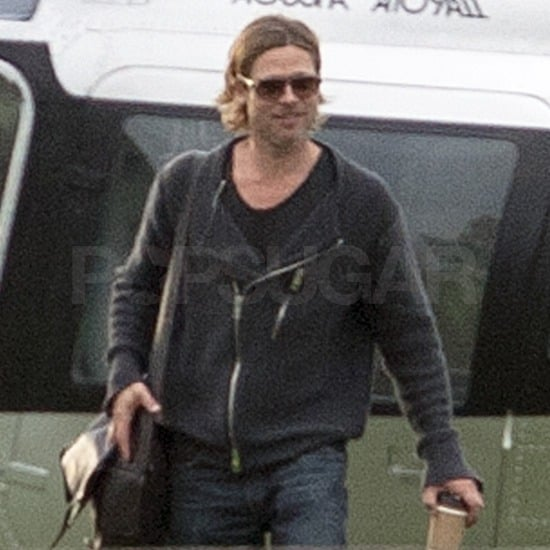 Brad Pitt smiled leaving the helipad.