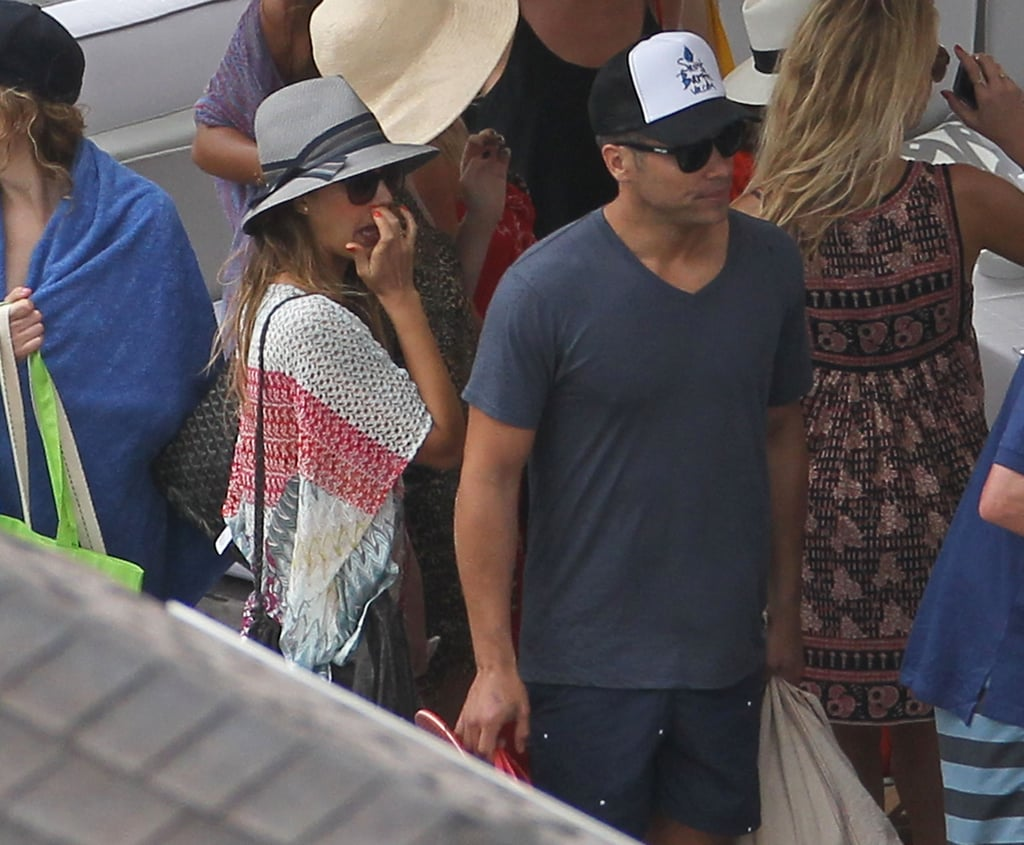 Jessica Alba and Cash Warren made their way through a crowd in St. Barts on Friday.