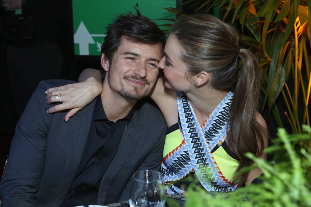 Miranda Kerr and Orlando Bloom cuddled at a pre-Oscars party.