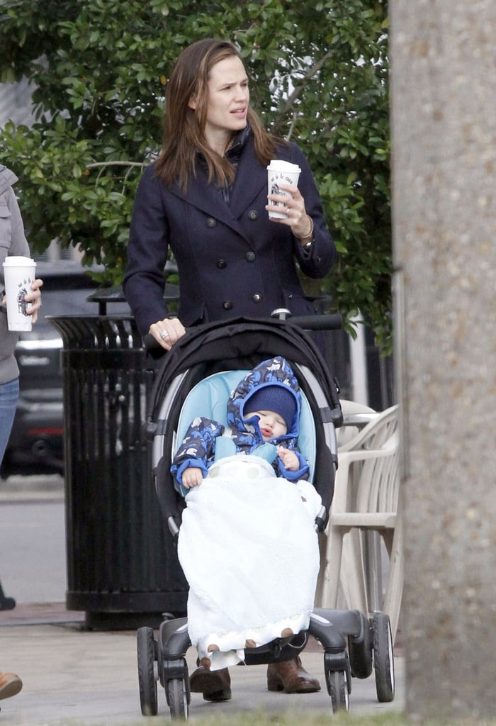 Jennifer Garner picked up a coffee to take Samuel Affleck for a stroll around New Orleans.