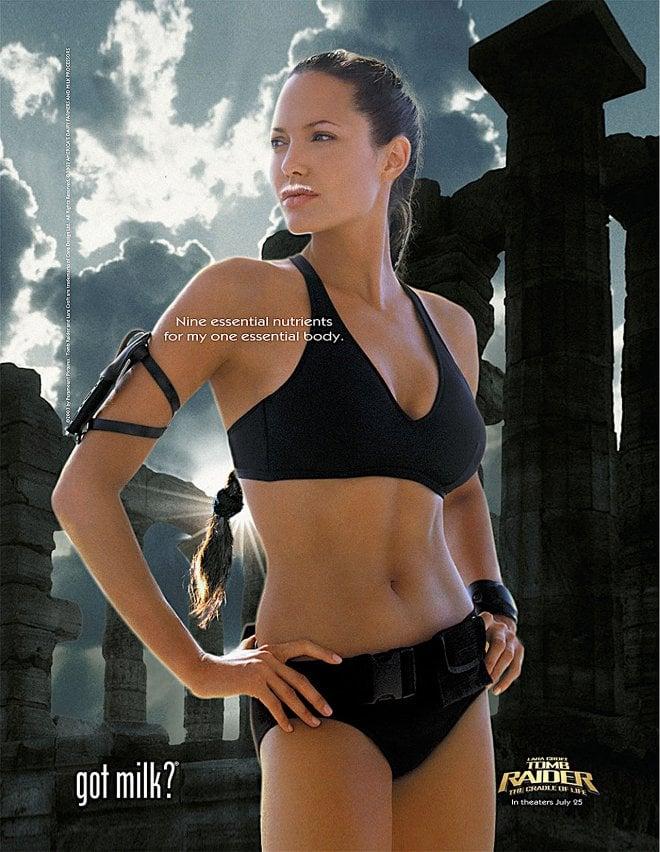 Angelina Jolie channeled Lara Croft, rocking a black bikini with her milk mustache.
