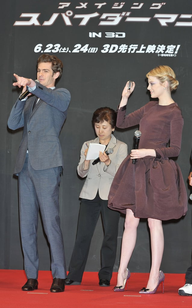 Emma Stone got her camera out to capture Andrew Garfield speaking to the crowd onstage at The Amazing Spider-Man premiere in Japan.