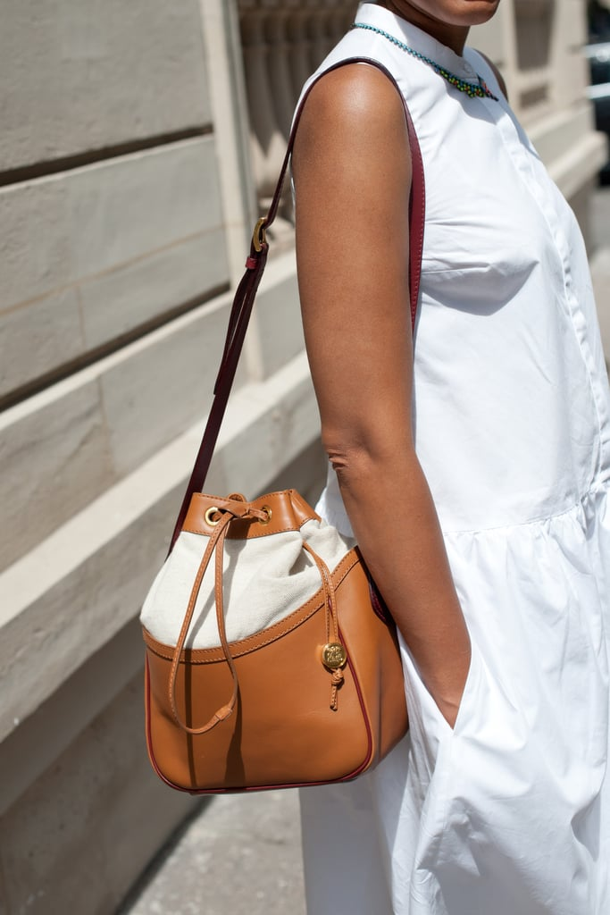 A bucket bag is the perfect low-key Summer complement to this LWD.