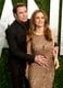 John Travolta embraced wife Kelly Preston on the red carpet.