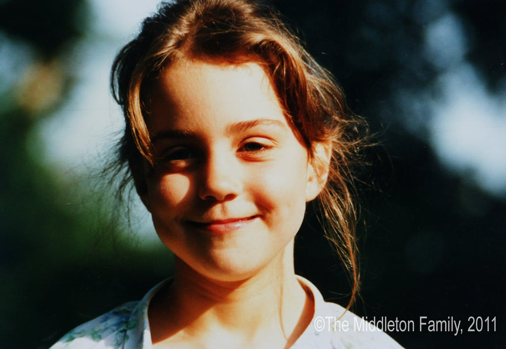 At five years old, Kate smiled on a Summer afternoon in the UK.   © The Middleton Family, 2011. All rights reserved.