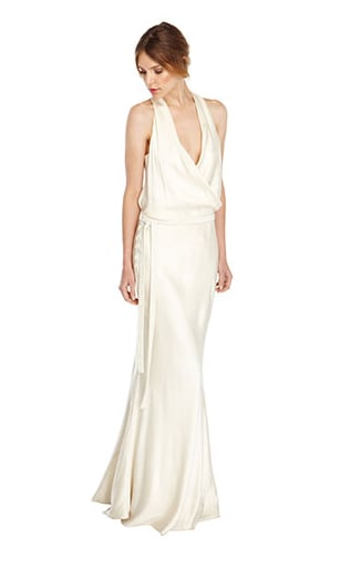 A cowl neckline offers a hint of the dramatic, but the easy silhouette feels uncomplicated so you won't look overdone at a beachy ceremony.  Nicole Miller Face Satin Bridal Gown ($1,100)
