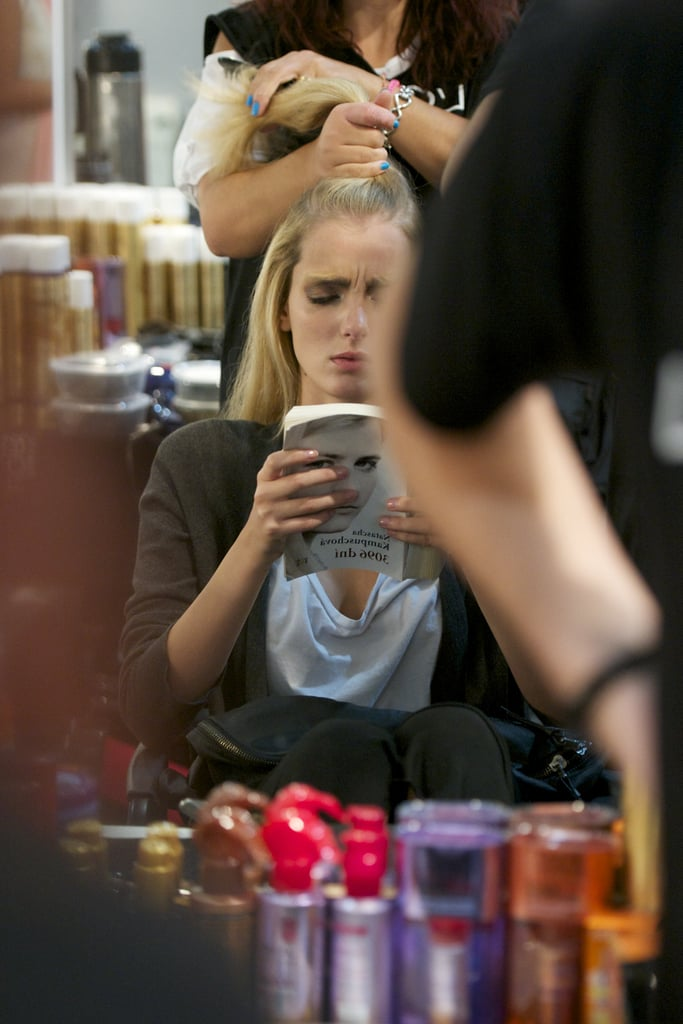 This model looked enthralled reading 3,096 Days by Natascha Kampusch during the Cibeles Madrid Fashion Week for Spring/Summer 2013.