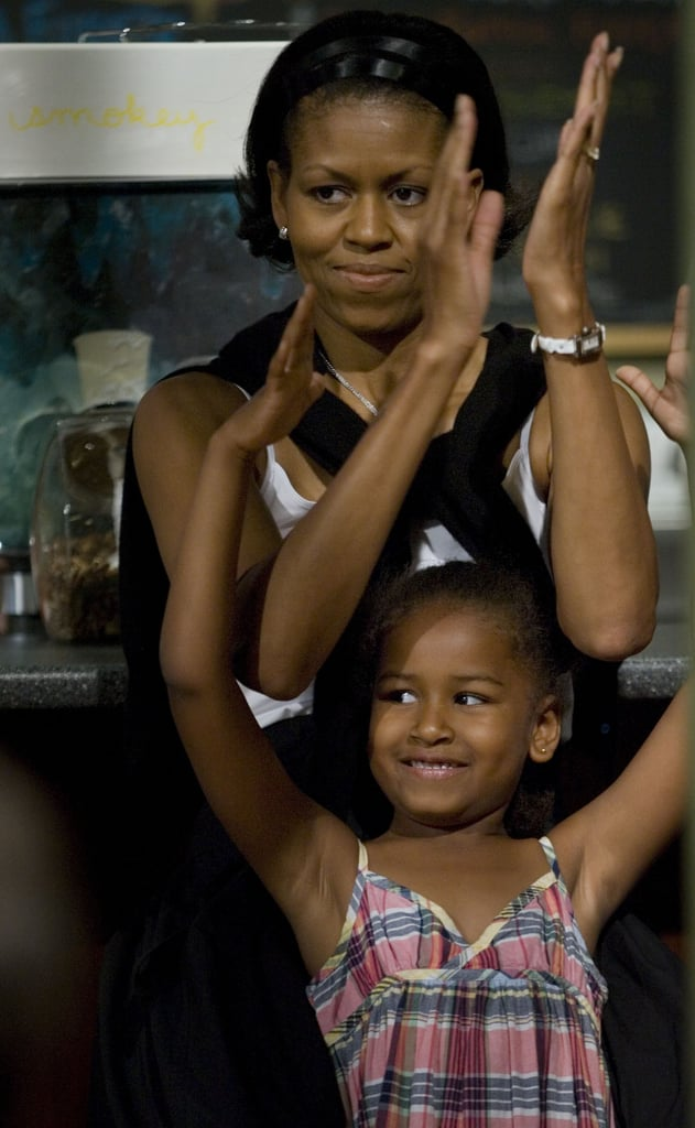 Michelle and Sasha, then 6, listened to Barack give a speech at Smokey Row Coffee in Iowa in 2007.