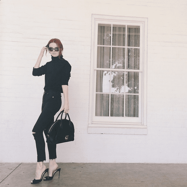 A black turtleneck brings office flair to your more casual distressed skinnies. Source: Instagram user seaofshoes