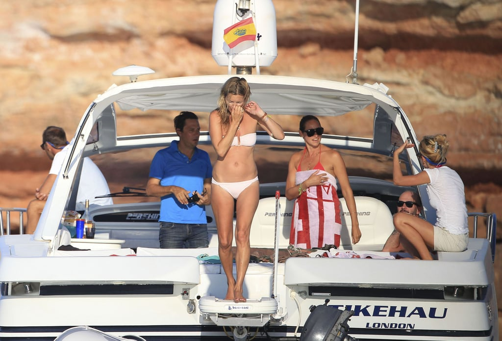 Kate Moss plugged her nose as she dove into the water during a getaway to Formentera, Spain, in August.