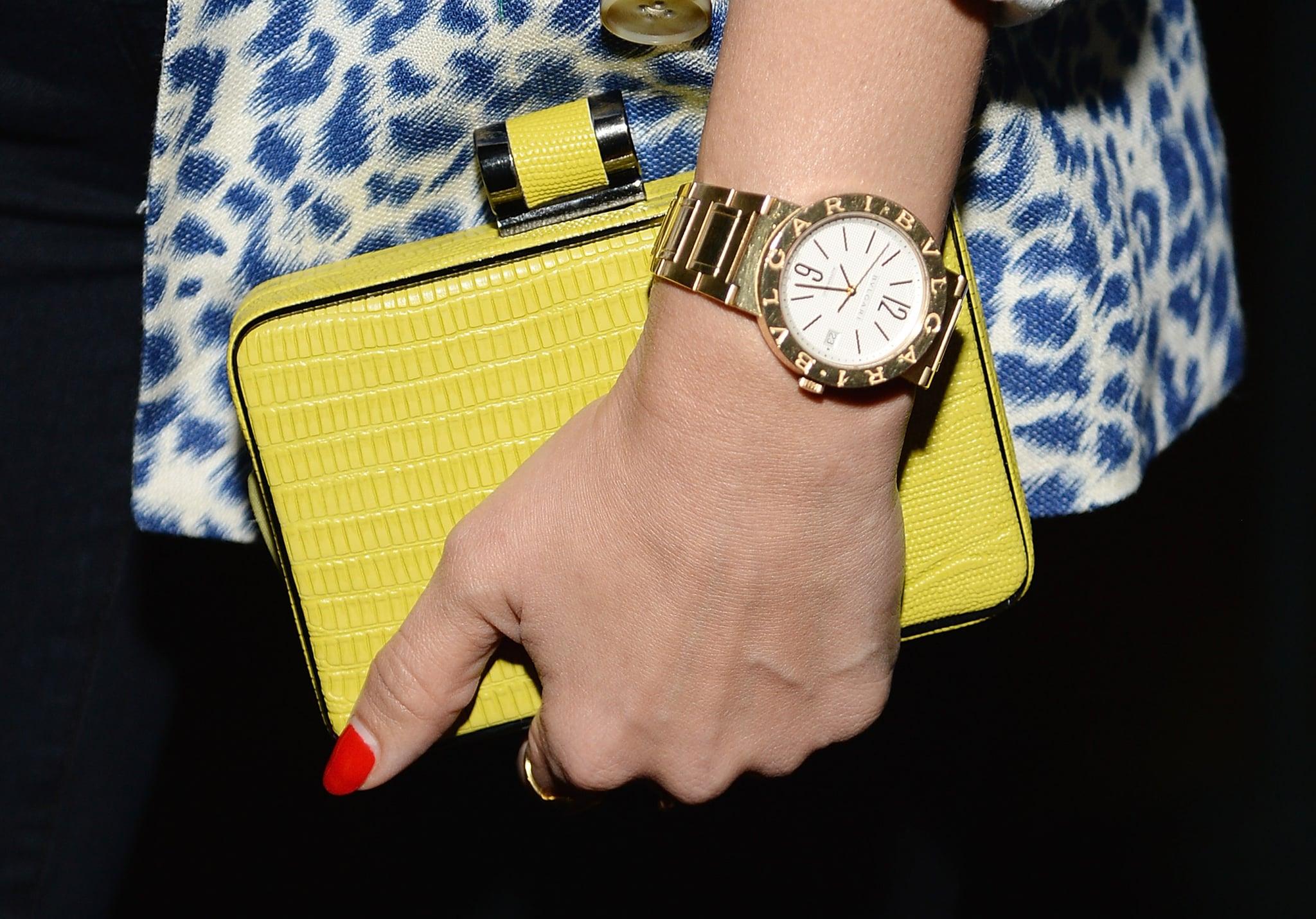 Jessica's bright clutch contrasted the blue hue of her jacket perfectly, and an oversize gold Bulgari watch was a piece that made a statement without overpowering.