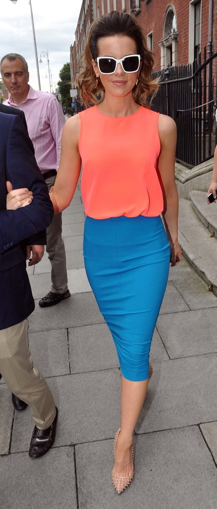 Kate paired a bright peach H&M top with an aqua-hued Diane von Furstenberg pencil skirt for a daytime Dublin appearance. Her Melinda Maria spiked earrings and ultraspiked Christian Louboutin Pigalle pumps edged up the look instantly.