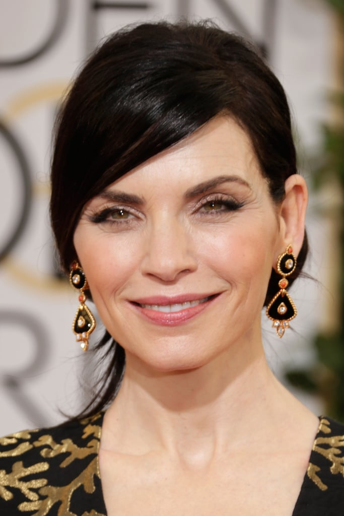 """Julianna Margulies echoed the black and gold of her gown with Van Cleef & Arpels """"1973"""" earrings."""
