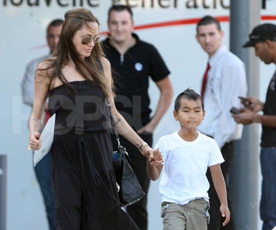Slide Photo of Angelina Jolie With Maddox Jolie-Pitt Leaving the Store in France