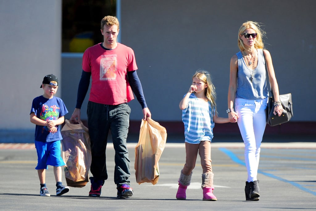 """Gwyneth Paltrow and Chris Martin took their kids, Apple and Moses, to Toys """"R"""" Us in LA in October 2012."""
