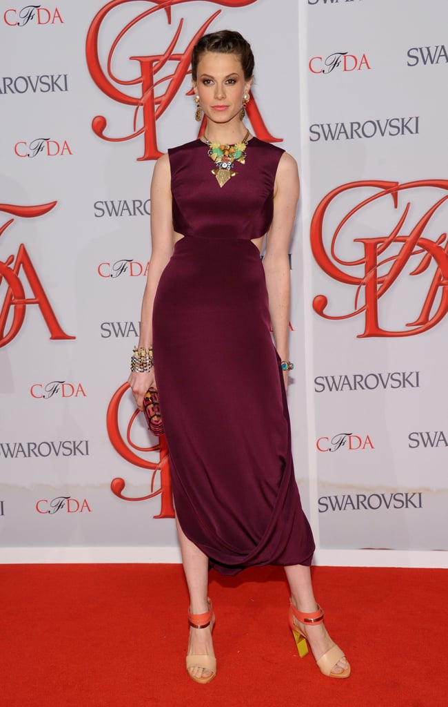 Elettra Wiedemann wore a silky plum-hued frock with a ruched hem and a cutout-infused waist. To give the look a funky spin, she rocked a bold statement necklace, too.