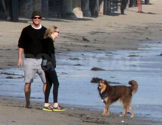 Josh Hartnett and Amanda Seyfried hang out with their dogs on the beach in LA.