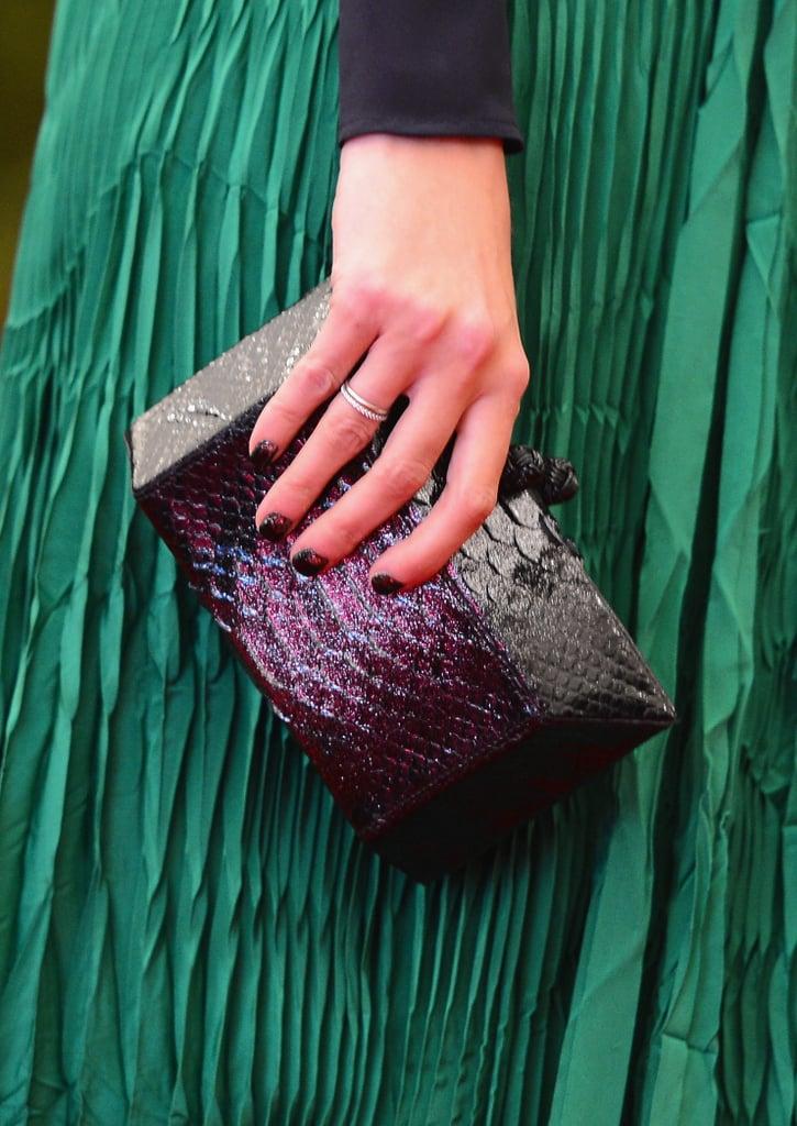 Ivanka Trump carried a colorful reptile-skin box clutch.