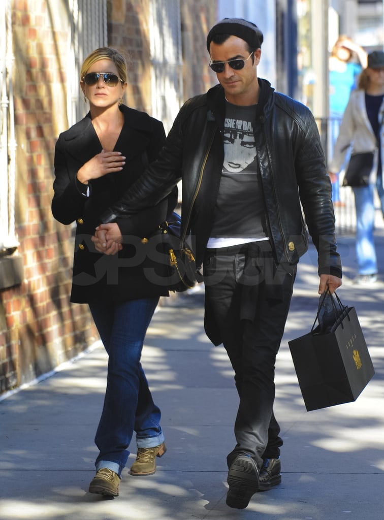 Jennifer Aniston and Justin Theroux holding hands.