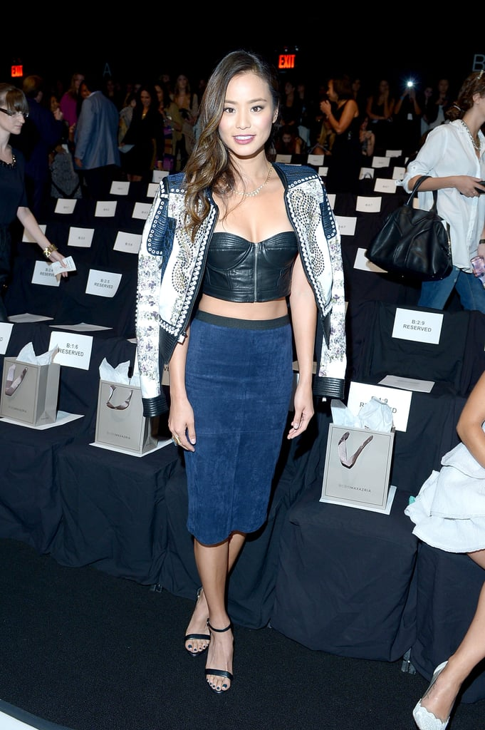 Jamie Chung put her daring foot forward at BCBG Max Azria in a black leather bustier crop top, a blue pencil skirt, and an embellished jacket, all by the designer.