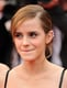 Emma Watson accessorized with three ear cuffs.