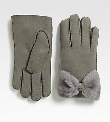 How does a gal stay warm and cute this season? Why, by sporting these UGG shearling bow gloves ($160) day and night.