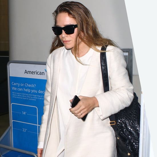 Mary-Kate Olsen Wearing a White Coat at the Airport
