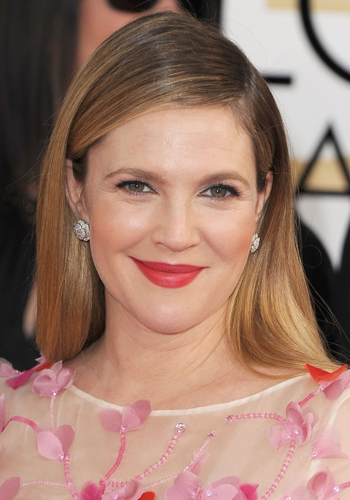 Drew Barrymore ditched the red and pink lip trend for a sherbet hue that complemented her pristine complexion.