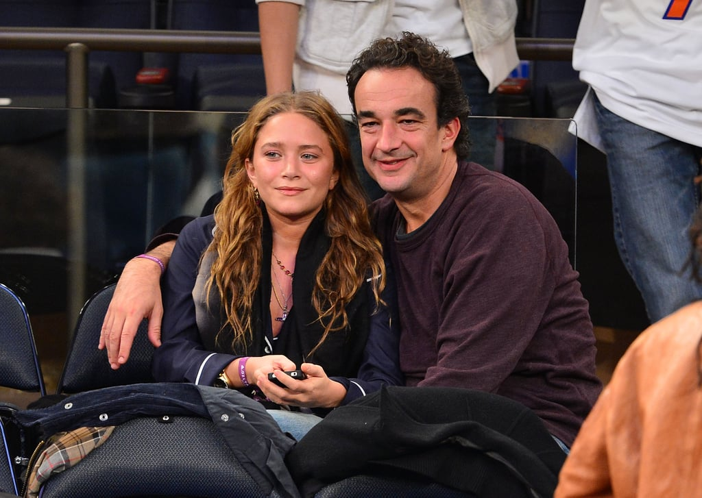 Mary-Kate Olsen held onto Olivier Sarkozy at the game.