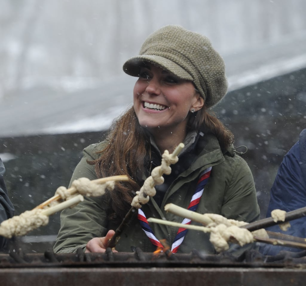 Kate Middleton smiled while grilled by the campfire.