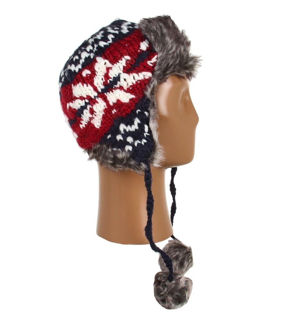 Speaking of prints, we adore the wintry pattern on this Dakine knit trapper hat ($35), as well as the mix of red, white, and navy.