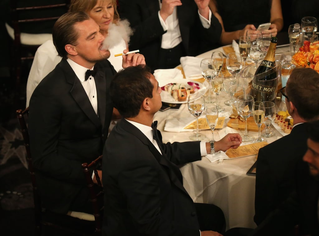 Leonardo DiCaprio lit up an electronic cigarette at his table, where he sat with the rest of his The Wolf of Wall Street cast.  Source: Christopher Polk/NBC/NBCU Photo Bank/NBC