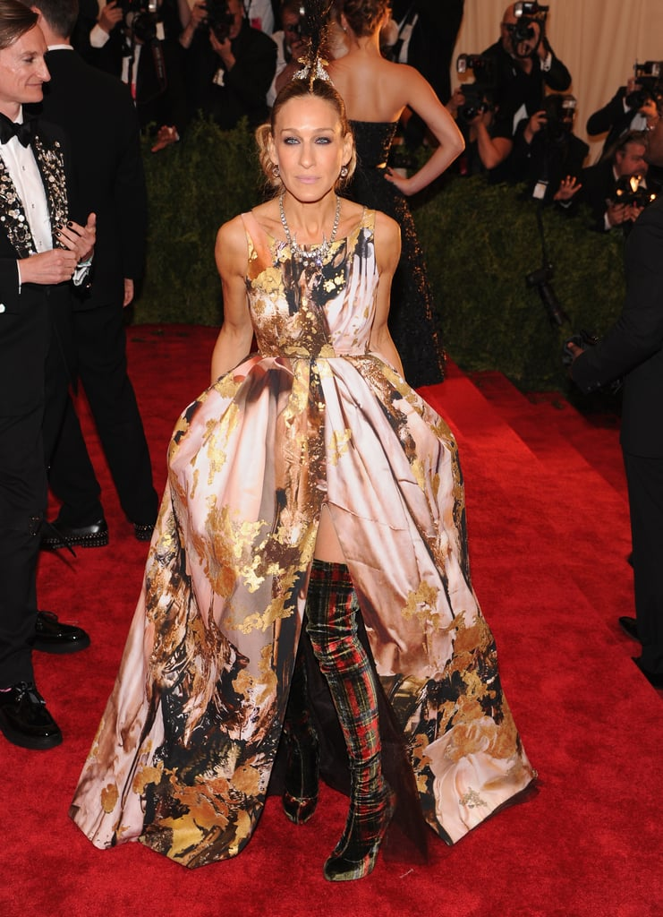 At the 2013 Met Gala, Sarah Jessica Parker had her most dramatic red carpet moment yet in a black-and-gold printed Giles Deacon gown, tartan thigh-high boots by Christian Louboutin, and a Philip Treacy mohawk headpiece.
