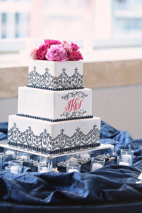 """The whimsical black trim, the pink peonies, the personalized initials — so much about this cake screams """"romantic.""""  Photo by Kristin Vining Photography via Style Me Pretty"""