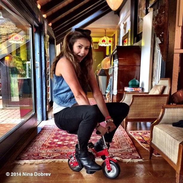 Nina Dobrev rode a tiny bike. Source: Instagram user ninadobrev