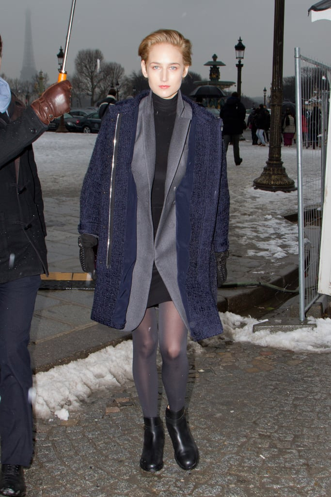 Leelee Sobieski layered up on muted gray and navy neutrals as she headed into the Dior Couture show.