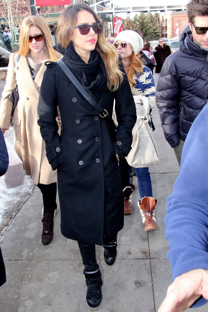 Jessica Alba strolled Park City in aTory Burch trench coat, coated denim, and high-top sneakers.