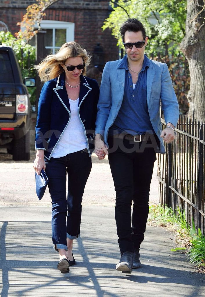 Kate Moss and Jamie Hince hold hands on a stroll near their home in London.