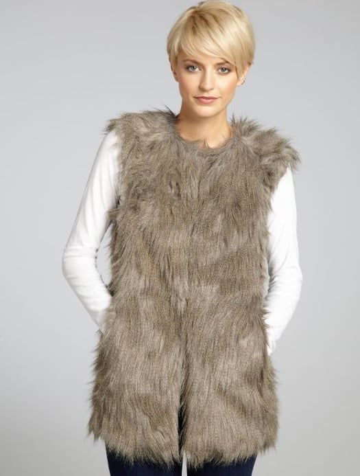 Cinch in this Romeo and & Juliet Couture Gray Fur Vest ($94) with a jeweled skinny belt for a sweet, ladylike twist.