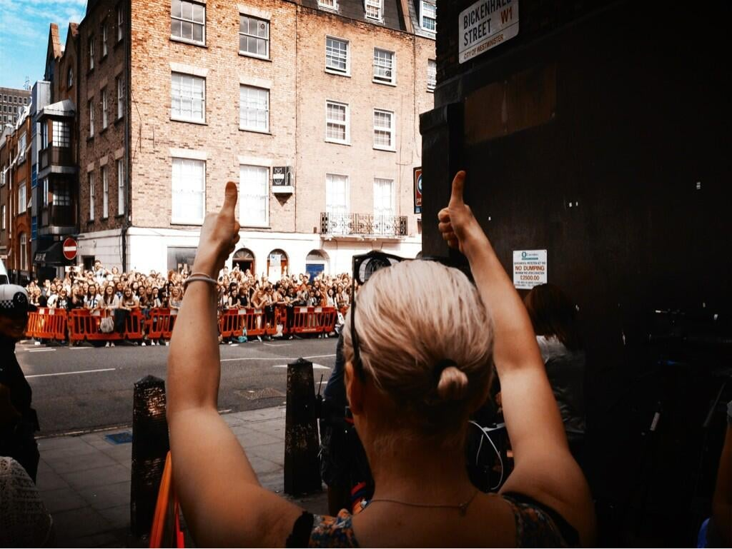 """Amanda Abbington, who plays Mary Morstan, John Watson's wife, thanked the crowd who turned out to glimpse a view of Sherlock season three filming: """"And that's a wrap . . . """" Source: Twitter user CHIMPSINSOCKS"""