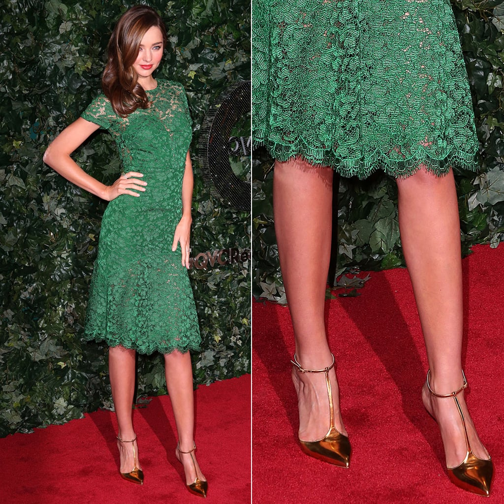 Miranda Kerr's green lace Burberry dress was complete with gold metallic t-strap sandals by Christian Louboutin at the QVC red carpet style event in Beverly Hills.