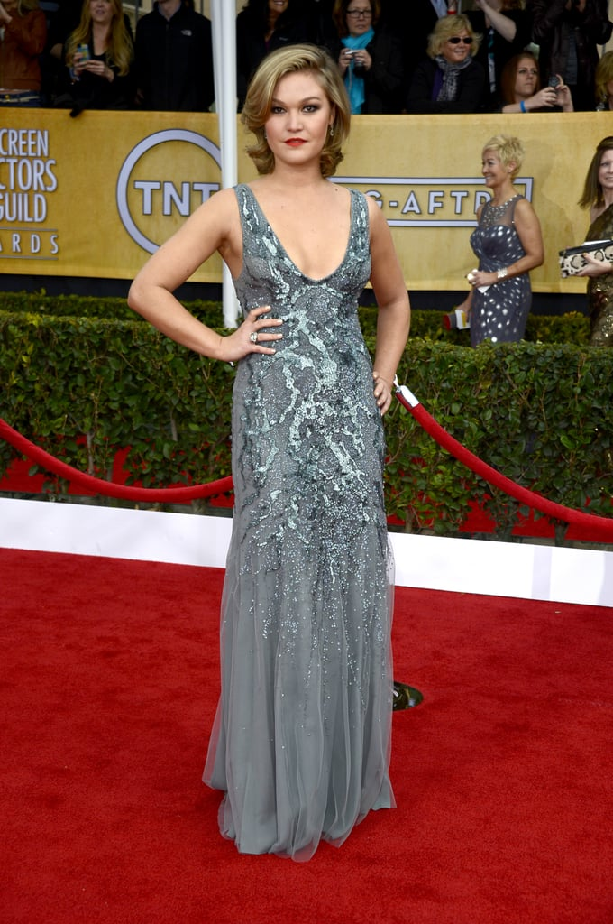 Julia Stiles donned a grey sequin-embellished gown by AMEN Couture with retro curls and a red lip.