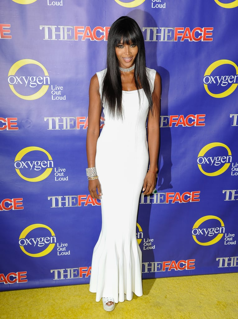 Naomi Campbell was streamlined in a white column dress at the premiere of The Face in NYC.