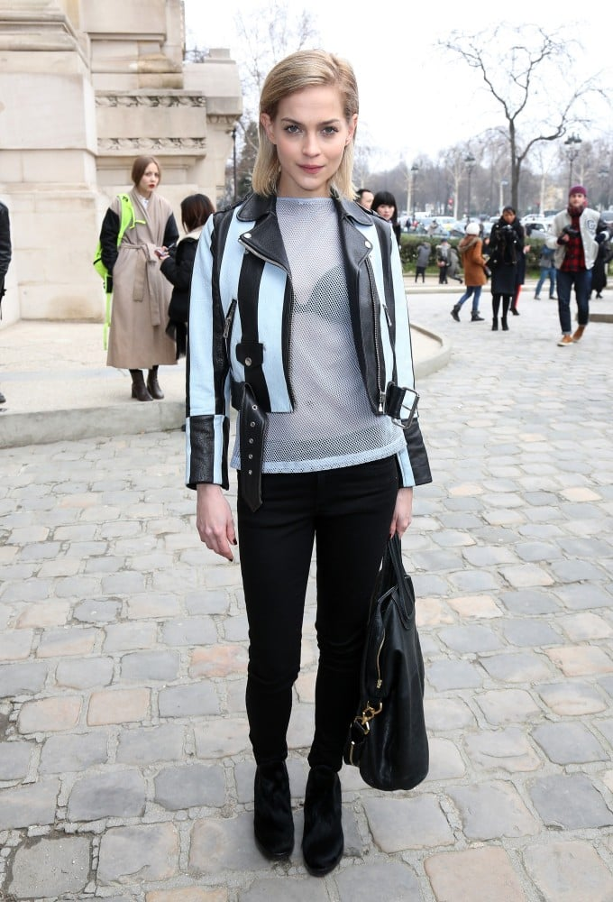 Outside the Acne show at PFW, Leigh Lezark went sheer in a netted top, which she topped with a striped biker leather jacket.